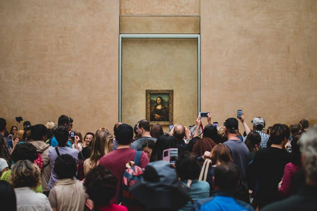 Crowds gather in front of Mona Lisa - overtourism