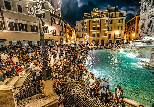 Big crowds gather around the famous Trevi Fountain